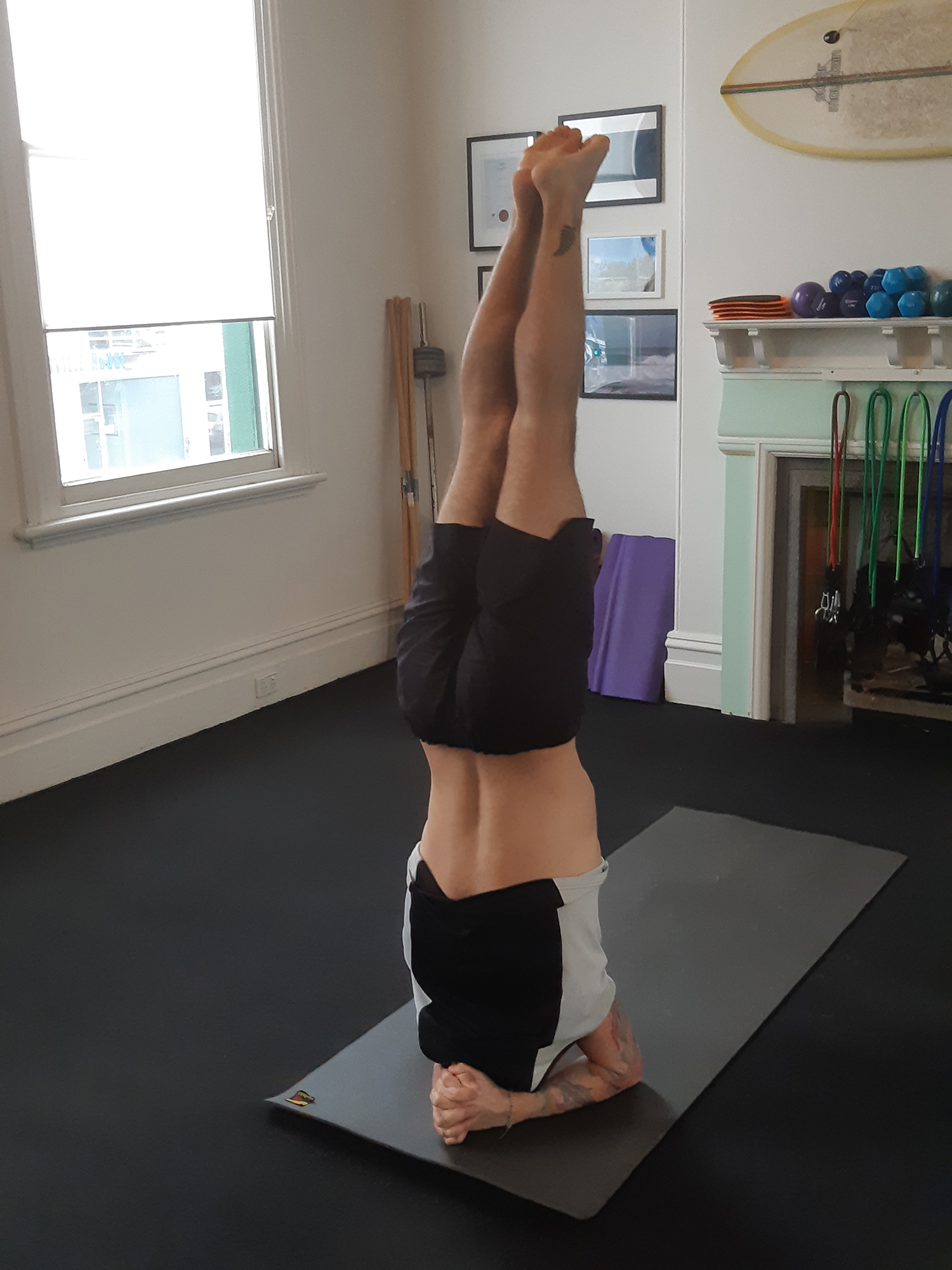 touch point massage yoga head stand back view